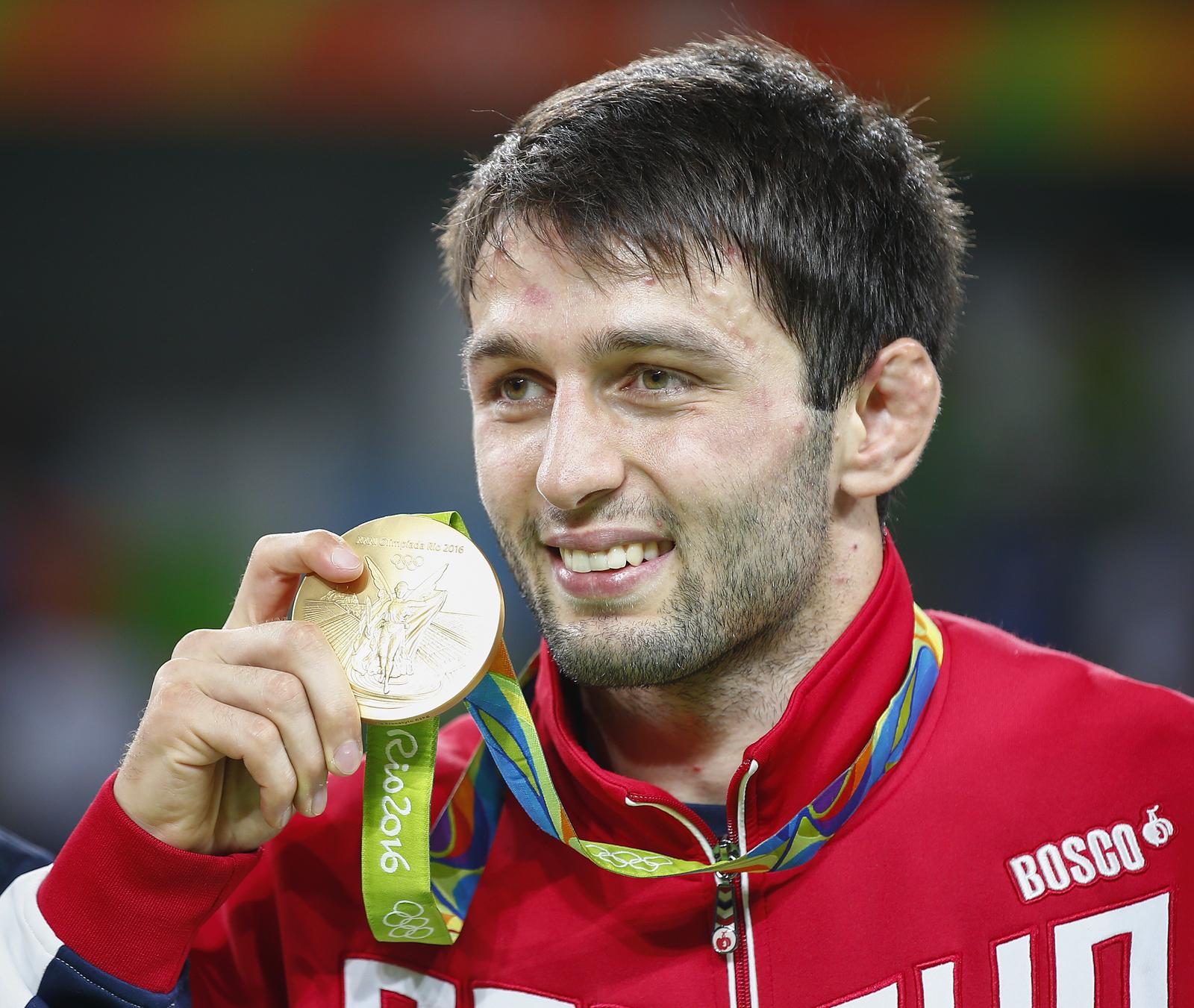 Борец Сослан Рамонов завоевал в последний день Олимпиады золотую медаль в своей весовой категории