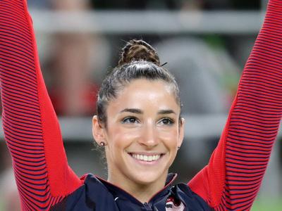 У чемпионки по гимнастике не разглядели мускулов, и она обиделась