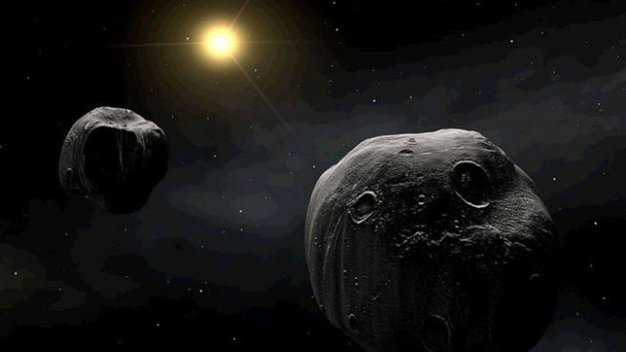 Часть земных кратеров - следы падения астероидов со спутниками