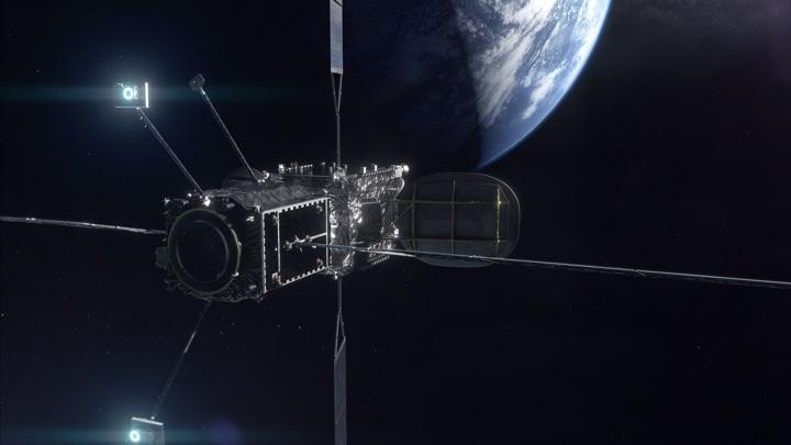 Аппарат MEV-2, пристыковавшийся к спутнику (художественное изображение).